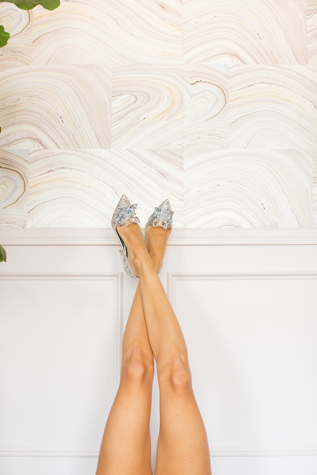 ALIA Crystal Covered Pointy Toe Pumps by Jimmy Choo featuring slender legs against a wall. By Santa Barbara wedding photographer Sarah Ellefson.
